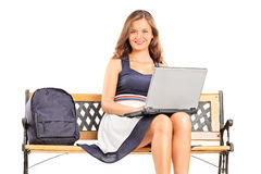 Young female student working on a laptop Royalty Free Stock Photos