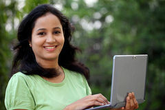 Young female student working with tablet computer Stock Photos