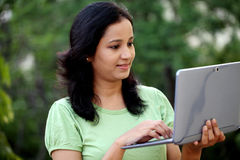Young female student working with tablet computer Royalty Free Stock Images