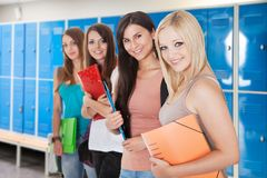 Young female students in changing room Stock Image