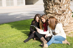 Young female students. Consulted on a tablet Stock Photography
