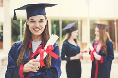 Young female students graduating from university stock photo