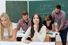 Young female students studying in the classroom Stock Images