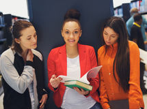 Young female students studying together for exams Royalty Free Stock Images