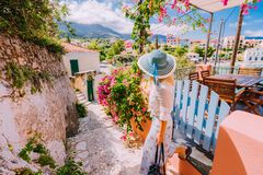 Young female on summer vacation in Greece looking towards wonderful summer day. Cute woman leaving the house and royalty free stock photography