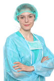 Young female surgeon doctor standing with arms crossed and smiling. Isolated. Stock Photo