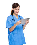 Young female surgeon using tablet Stock Images