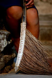 Young female sweeper in Angkor Wat (Cambodia). Young girl with a broom; sweeper in Angkor Wat, Cambodia Royalty Free Stock Photo