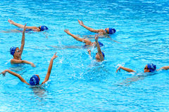 Young female swimmers. VARNA, BULGARIA - APRIL 24, 2016: Young female swimmers from Albatros club in Varna during synchronously swimming practice Royalty Free Stock Images