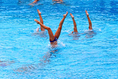 Young female swimmers. VARNA, BULGARIA - APRIL 24, 2016: Young female swimmers from Albatros club in Varna during synchronously swimming practice Royalty Free Stock Image