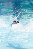 Young Female Swimming Backstroke. A young female swims the backstroke at a swim competition Stock Images