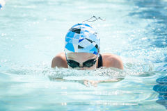 Young Female Swimming Breaststroke Royalty Free Stock Photos