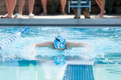 Young Female Swimming Butterfly Stock Image