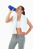 Young female taking a sip Stock Photography
