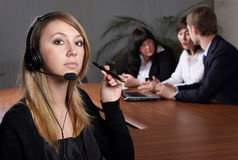 Young female talk by  headset Stock Photo