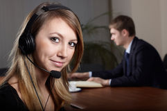 Young female talk by  headset. With microphone in office Stock Image