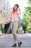 Young female talking on cellphone outdoors Royalty Free Stock Photo