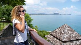 Young Female Talking on the Phone near Sea stock footage