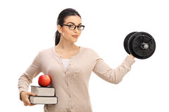 Young female teacher lifting a dumbbell. And looking at the camera isolated on white background royalty free stock image