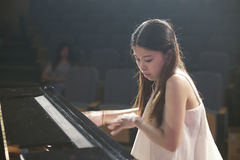Young female teacher of stars river art  centre play piano Royalty Free Stock Images