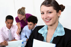 Young female teacher and students Stock Photo