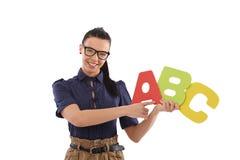 Young female teacher teaching alphabet smiling