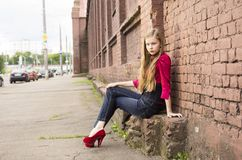 Young female teen girl pose against a brick wall. Royalty Free Stock Photography