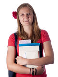 Young female teenage student carrying books Royalty Free Stock Photography
