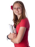 Young female teenage student carrying books Stock Images