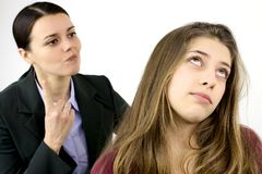 Young female teenager annoyed by angry mother. Teenager sick of listening mother Royalty Free Stock Photos