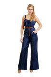 Young female teenager in jeans jumpsuit Royalty Free Stock Photo