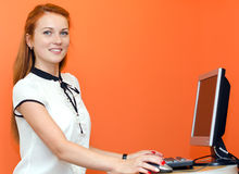 Young female teller. At working place Stock Image