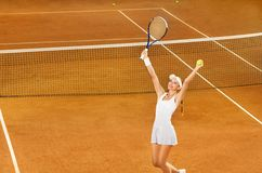 Female tennis player celebrating victory Royalty Free Stock Images