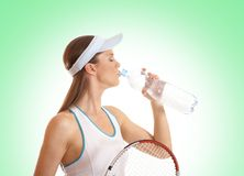 A young female tennis player is drinking water Stock Photography