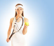 A young female tennis player with equipment Stock Images