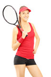 Young female tennis player posing Royalty Free Stock Photo