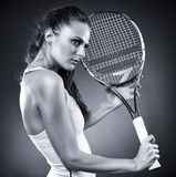 Young female tennis player with racket Stock Photography