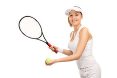 Young female tennis player serving Royalty Free Stock Photos