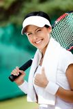 Young female tennis player with towel Royalty Free Stock Images