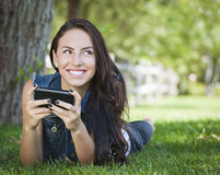 Young Female Texting on Cell Phone Outside Royalty Free Stock Photo