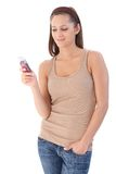 Young female texting smiling Royalty Free Stock Photo