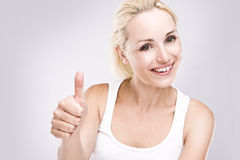 young female with thumbs up. Stock Photos