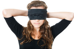 Young female tie her eyes Stock Photo