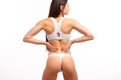 Young female touching her painful back Royalty Free Stock Photography