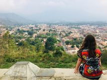 A young female tourist admiring Antigua, Guatemala from the cerr royalty free stock photography