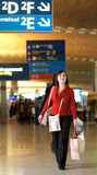 Young female tourist in the airport Royalty Free Stock Image