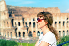 Young female tourist on the background of the Colosseum in Rome Royalty Free Stock Photos