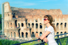 Young female tourist on the background of the Colosseum in Rome Stock Image