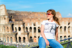Young female tourist on the background of the Colosseum in Rome Stock Photos