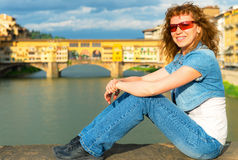 Young female tourist on the background of the Ponte Vecchio in F Stock Photography